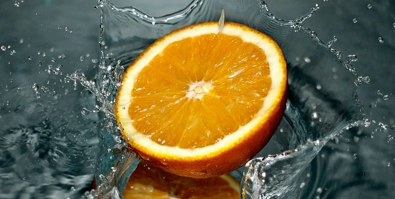 orange fruit and water